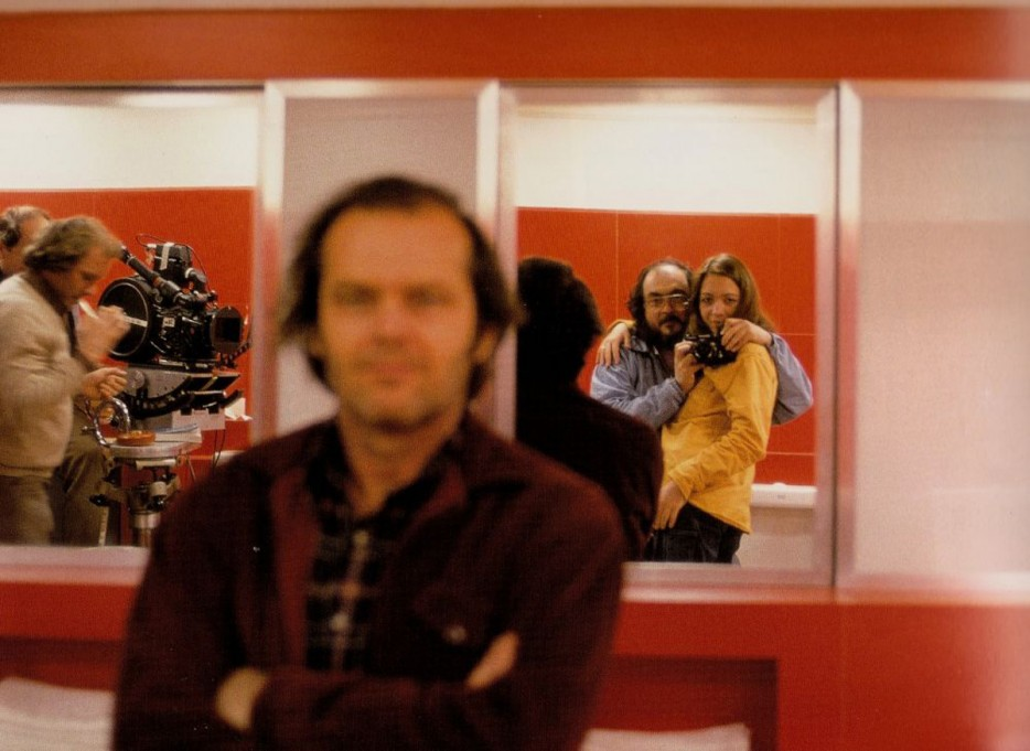Stanley Kubrick sneaks a photo over Jack Nicholson's shoulder